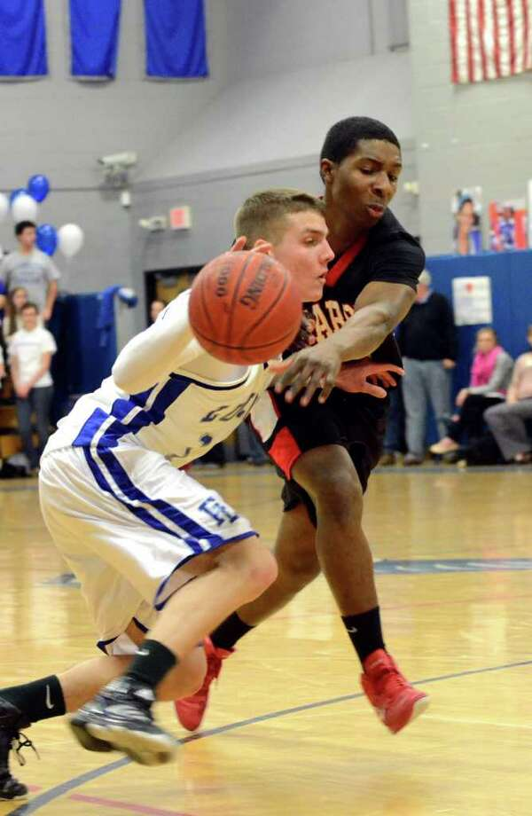 Warde's Kadeem Mundle swats the ball out of Ludlowe's Erik Krumins grasp during the boys basketball game at Fairfield Ludlowe on Monday, Feb. 14, 2011. Photo: Amy Mortensen / Connecticut Post Freelance