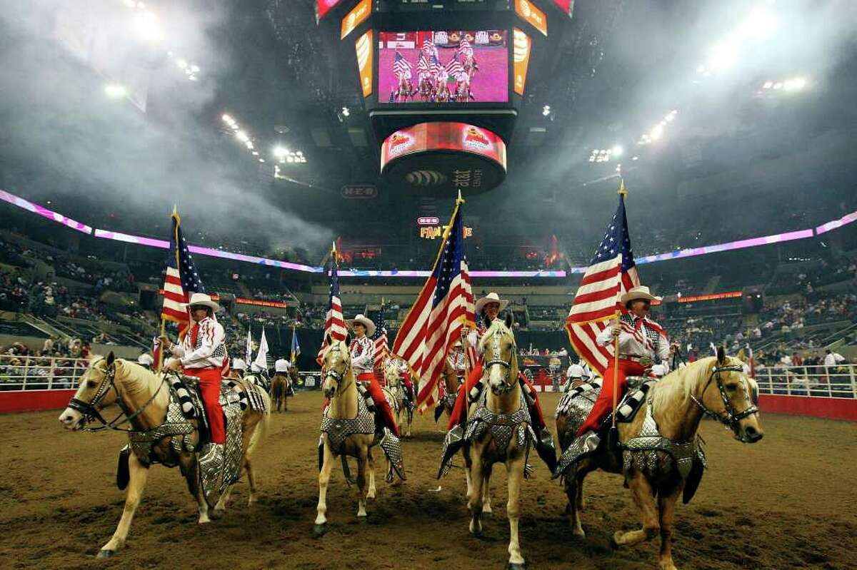 FOR METRO - Members of the Jack Sellers Bexar County Palomino Patrol take part in the Grand Entry Monday Feb. 14, 2011 during the San Antonio Stock Show & Rodeo at the AT&T Center. (PHOTO BY EDWARD A. ORNELAS/eaornelas@express-news.net)