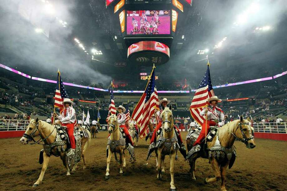 FOR METRO - Members of the Jack Sellers Bexar County Palomino Patrol take part in the Grand Entry Monday Feb. 14, 2011 during the San Antonio Stock Show & Rodeo at the AT&T Center. (PHOTO BY EDWARD A. ORNELAS/eaornelas@express-news.net) Photo: EDWARD A. ORNELAS, SAN ANTONIO EXPRESS-NEWS / eaornelas@express-news.net