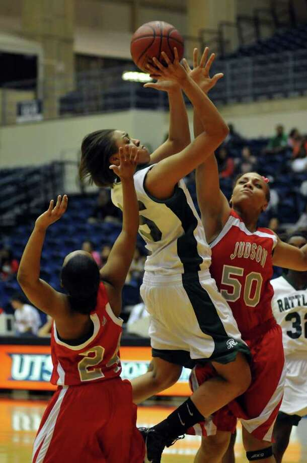 SLUG: BKG/5A bidistrict doubleheader-Photo Request 52764-Feb 14, 2011-San Antonio, Texas---Reagan's Sabrina Berry shoots between Judson's Emara (cq) Towns (24) and Cheyenne Miller (50) during first half 5A playoof action 2/14.  Photo by Robin Jerstad/Special to the Express-News Photo: ROBIN JERSTAD                       , Photo By Robin Jerstad/Special To The Express-News / Copyright 2011 by Robin Jerstad