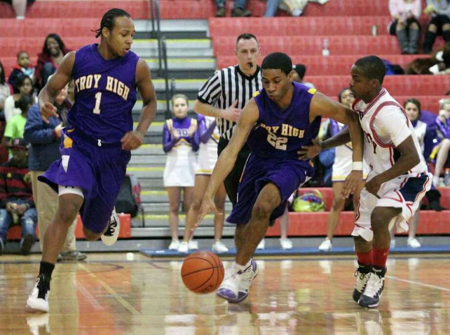 High school winter sports -- boys' basketball Troy's John Pompey (22) drives upcourt with teammate Shadell Millinghaus, left, past Schenectady's Kumar Araujo, right, during Monday night's boys' high school  basketball game in Schenectady. Troy won 72-52. (Patrick Dodson / Special to the Times Union) Photo: Patrick Dodson / 10012069A
