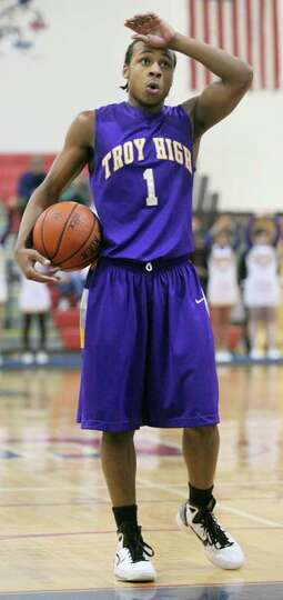 High school winter sports -- boys' basketball Troy's Shadell Millinghaus, who formerly played for S