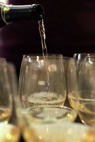 "7. Serving white wines too cold: White wines suffer from the opposite problem — being served too cold. ""Over-chilled white wines tend to lock up...,"" says Tanji Patton, a food and wine writer and Emmy-award-winning journalist. ""A white wine that is straight from the refrigerator is not nearly as interesting as one that sits out about 15 minutes before serving. The wine becomes much more expressive — more flavors show through."" Photo: JENNIFER WHITNEY, Special To The Express-News / special to the Express-News"