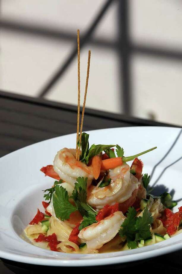 Jumbo shrimp with cilantro butter and linguine, at The Grill at Leon Springs, uses a few simple ingredients that pack flavor into every bite. Photo: JERRY LARA, San Antonio Express-News / glara@express-news.net