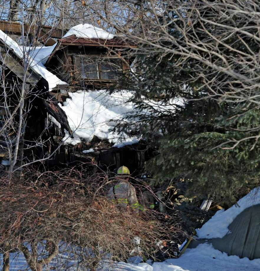 Troy firefighters responded to a building collapse at 226 Cemetery Road in Troy on Tuesday, Feb. 15, 2011 and found major damage to the building.    (Skip Dickstein / Times Union) Photo: Skip Dickstein / 2008