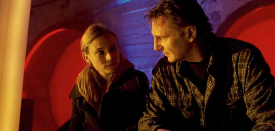 "DIANE KRUGER as Gina and LIAM NEESON as Dr. Martin Harris in Dark Castle Entertainment's thriller ""UNKNOWN,"" a Warner Bros. Pictures release."