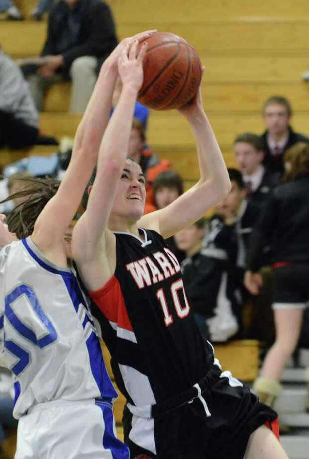 Warde's Kate Kerrigan attempts a shot as Ludlowe's Pauline Blatt defends during the girls basketball game at Fairfield Ludlowe on Monday, Feb. 14, 2011. Photo: Amy Mortensen / Connecticut Post Freelance