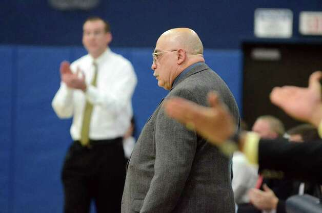 Staples' boys basketball coach Vito Montelli reacts to a call made during the boys basketball game against St. Joseph at Staples on Monday, Feb. 14, 2011. Staples' boys coach Colin Devine applauds the call. Photo: Amy Mortensen / Connecticut Post Freelance