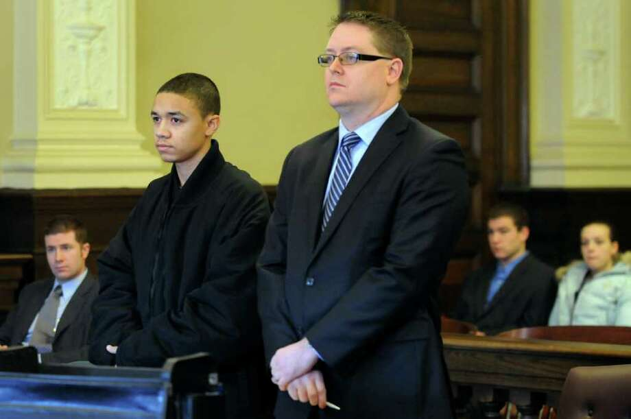 Kemo Santana, 18, left, stands with his attorney, Joe Ahearn, when he pleaded guilty to manslaughter in connection with the death of a New York City man in Troy. (Cindy Schultz / Times Union) Photo: Cindy Schultz