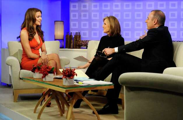 """In this photo released by NBC Universal, Sports Illustrated swimsuit cover model Irina Shayk, left, talks with """"Today"""" show co-hosts Meredith Vieira and Matt Lauer about being picked for the cover of the swimsuit edition of Sports Illustrated, on the """"Today"""" show, Tuesday, Feb. 15, 2011, in New York. (AP Photo/NBC, Peter Kramer) NO SALES Photo: AP"""