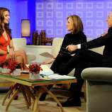 """In this photo released by NBC Universal, Sports Illustrated swimsuit cover model Irina Shayk, left, talks with """"Today"""" show co-hosts Meredith Vieira and Matt Lauer about being picked for the cover of the swimsuit edition of Sports Illustrated, on the """"Today"""" show, Tuesday, Feb. 15, 2011, in New York. (AP Photo/NBC, Peter Kramer) NO SALES"""