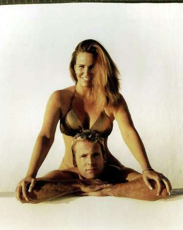 **FILE**This file photo originally supplied by Sports Illustrated shows actress Tawny Kitaen, in the Sports Illustrated Swimsuit edition that came out Feb. 10, 1999. Kitaen has been charged with felony drug possession after sheriff's deputies said they found cocaine in her apartment. The 45-year-old actres  is scheduled to be arraigned Dec. 18  in Laguna Niguel, Calif., said Susan Kang Schroeder, a spokeswoman for the Orange County district attorney's office, on Tuesday, Nov. 21, 2006. Photo: AP / SPORTS ILLUSTRATED