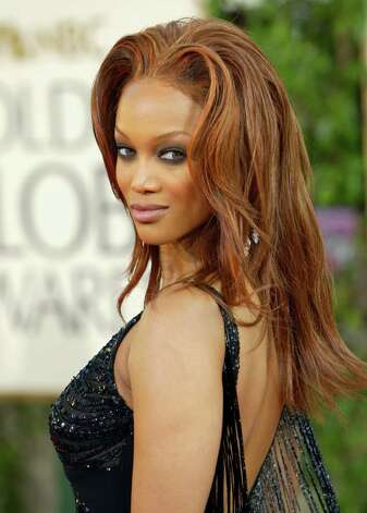 """Model Tyra Banks arrives for the 61st Annual Golden Globe Awards on Sunday, Jan. 25, 2004, in Beverly Hills, Calif. Known for gracing the Sports Illustrated swimsuit issue and the Victoria's Secret catalog, Banks is moving into life beyond the runway. """"The (modeling) industry represents a revolving door: The new ones come and the old ones go. I'm still in there, but I'm ready to kick myself out soon,'' Banks tells TV Guide for its March 20, 2004 issue. Photo: KEVORK DJANSEZIAN, AP / AP"""