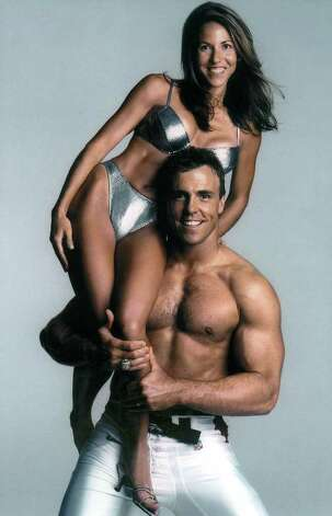 Julie and Bill Romanowski are shown in the 2000 Sports Illustrated swimsuit issue. Photo: AP / SPORTS ILLUSTRATED