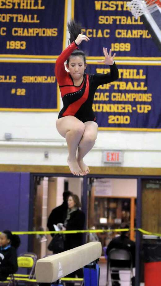 Ji Young Anderson performs for Fairfield Warde high school on the balance beam during the 2011 FCIAC Gymnastics Championships at Westhill high school in Stamford on Saturday Feb. 12, 2011. Photo: Lisa Weir / The News-Times Freelance
