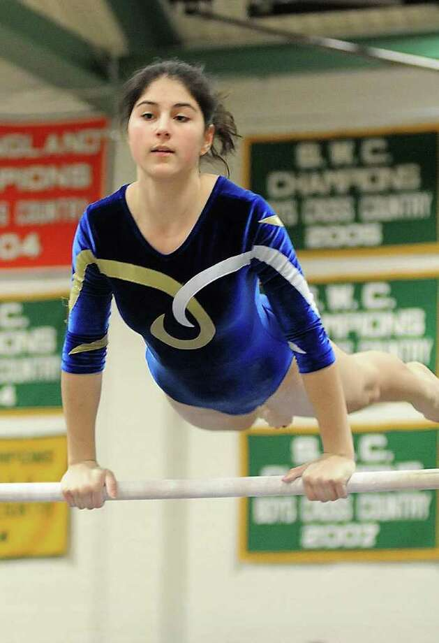 Weston's, Lena Romaldini, performs on the uneven bars during the SWC champuionships at New MIlford HIgh school on Thursday, Feb. 10, 2011. Photo: Lisa Weir / The News-Times Freelance