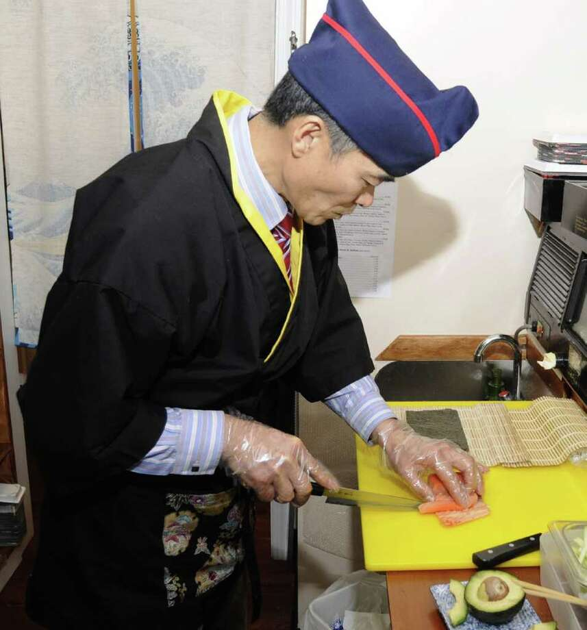 Sushi chef Jay Lim, owner of Edo II, in Danbury, prepares  a Philadelphia Roll. Photo: Jay Weir / The News-Times Freelance