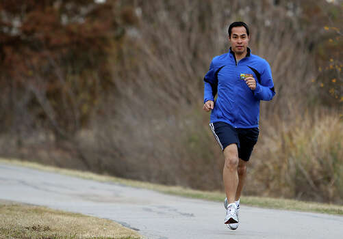 "As a runner, Julián Castro seems to recognize the opportunity to be a fitness role model. ""I am trying to create a fitter city for San Antonio,"" he says. KIN MAN HUI / EXPRESS-NEWS / San Antonio Express-News"