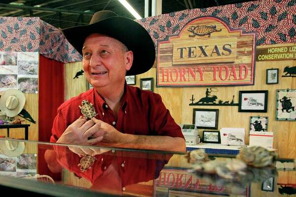 Vendor and artisan Tom McCain of Horny Toad Connection, Inc. shows one of his many sculpted horned lizards at this booth in the Texas Star Marketplace at the San Antonio Stock Show and Rodeo.
