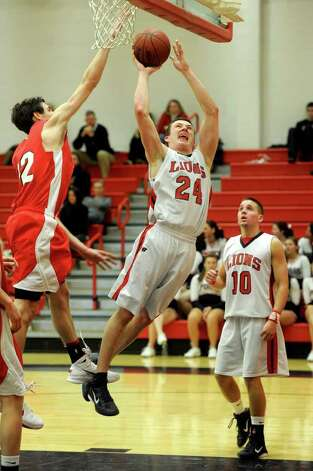 Foran's Nick Willey takes a shot as Fairfield Prep's Terry ...