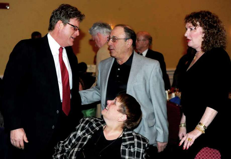 Ted Kennedy Jr., left, greets supporters during the JFK Legacy Dinner, held to honor the 50th anniversary of the inauguration of President John F. Kennedy, at Testo's Restaurant in Bridgeport on February 15, 2011. Photo: Lindsay Niegelberg / Connecticut Post