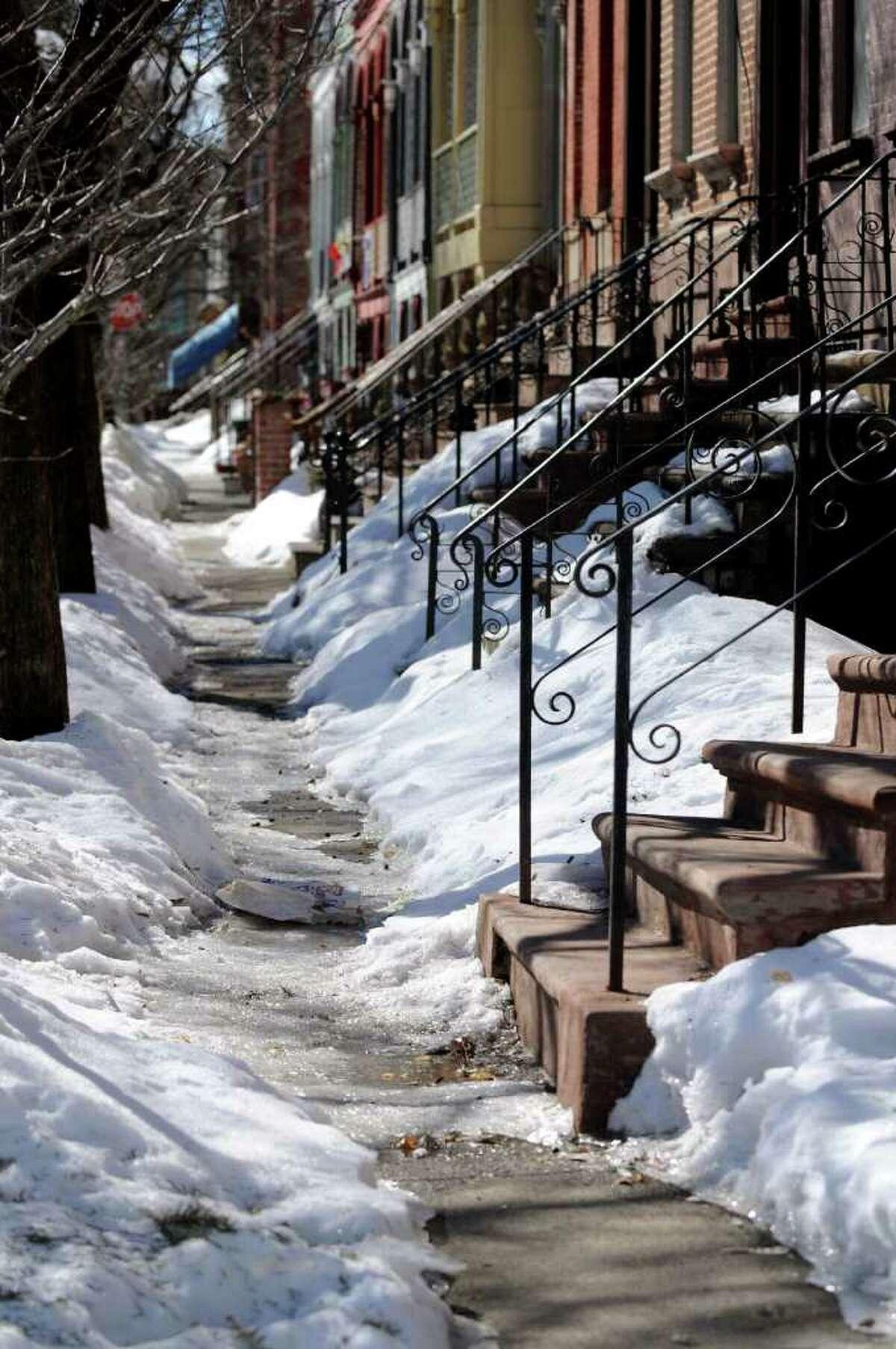 An icy, residential sidewalk in Arbor Hill on Tuesday, Feb. 15, 2011, in Albany, N.Y. (Cindy Schultz / Times Union)