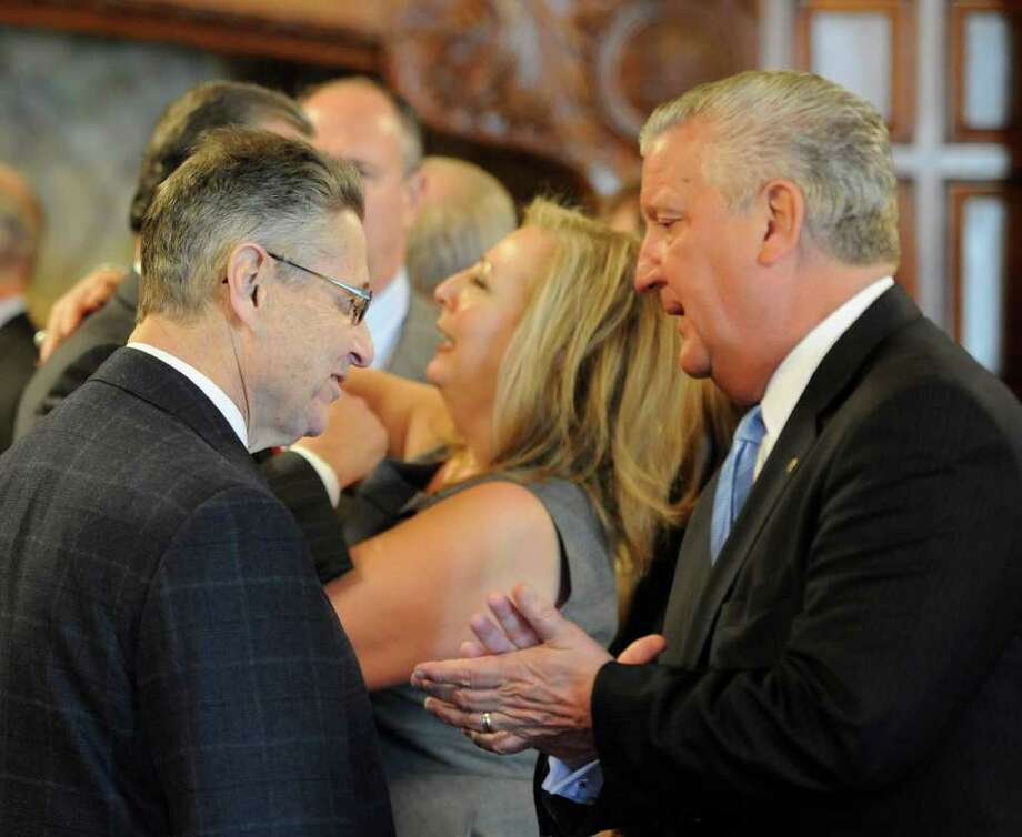 Assembly Speaker Sheldon Silver, left, makes a brief appearance while speaking with Albany Mayor Jerry Jennings before Court of Appeals Chief Judge Jonathan Lippman delivered his State of the Judiciary speech Tuesday February 15, 2011 in the Court of Appeals Chamber in Albany.  (Skip Dickstein / Times Union) Photo: Skip Dickstein