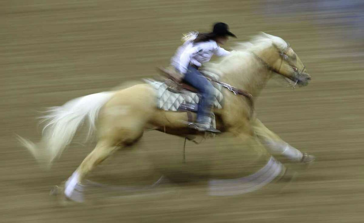 Brittany Pozzi of Victoria finished first with a time of 13.75 in the barrel racing event at the 2011 San Antonio Stock Show & Rodeo on Tuesday, Feb. 15, 2011. Kin Man Hui/kmhui@express-news.net
