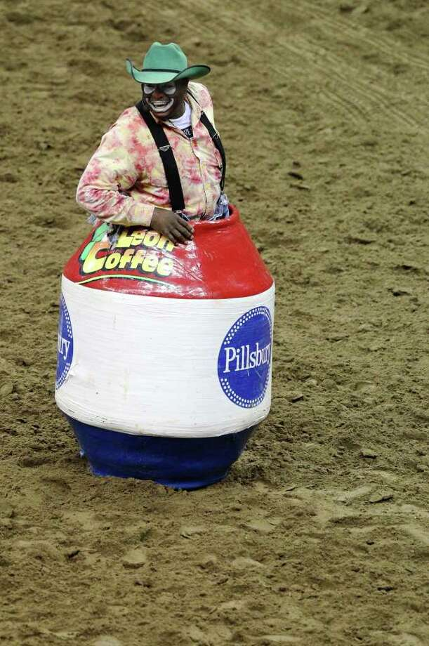Bull fighter Leon Coffee finds a spot to view the bull riding competition at the 2011 San Antonio Stock Show & Rodeo on Tuesday, Feb. 15, 2011. Kin Man Hui/kmhui@express-news.net Photo: KIN MAN HUI, SAN ANTONIO EXPRESS-NEWS / San Antonio Express-News