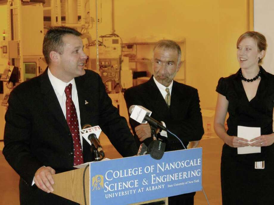 Professor Thomas Begley, left, addresses those gathered for a press event to announce the creation of the NanoHealth and Safety Center Tuesday, Feb. 15, 2011 at Albany NanoTech.  Also in attendance was NanoCollege Ceo Alain Kaloyeris, center, and NanoCollege Professor Sara Brenner, right.  Begley and Brenner will be overseeing the project.   (Larry Rulison / Times Union) Photo: Larry Rulison / 10012085A