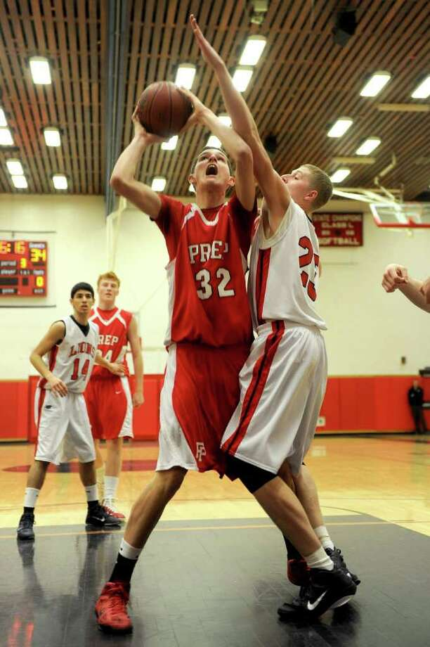 Fairfield Prep's Matt Daley takes a shot as Foran's Austin Woods blocks during Tuesday's game at Foran High School in Milford on February 15, 2011. Photo: Lindsay Niegelberg / Connecticut Post