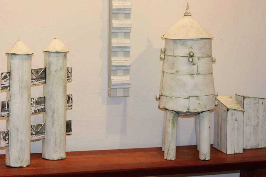 "Recent works by ceramics artist Mary Fischer, including ""Water Tower with Knobs"" on the right."