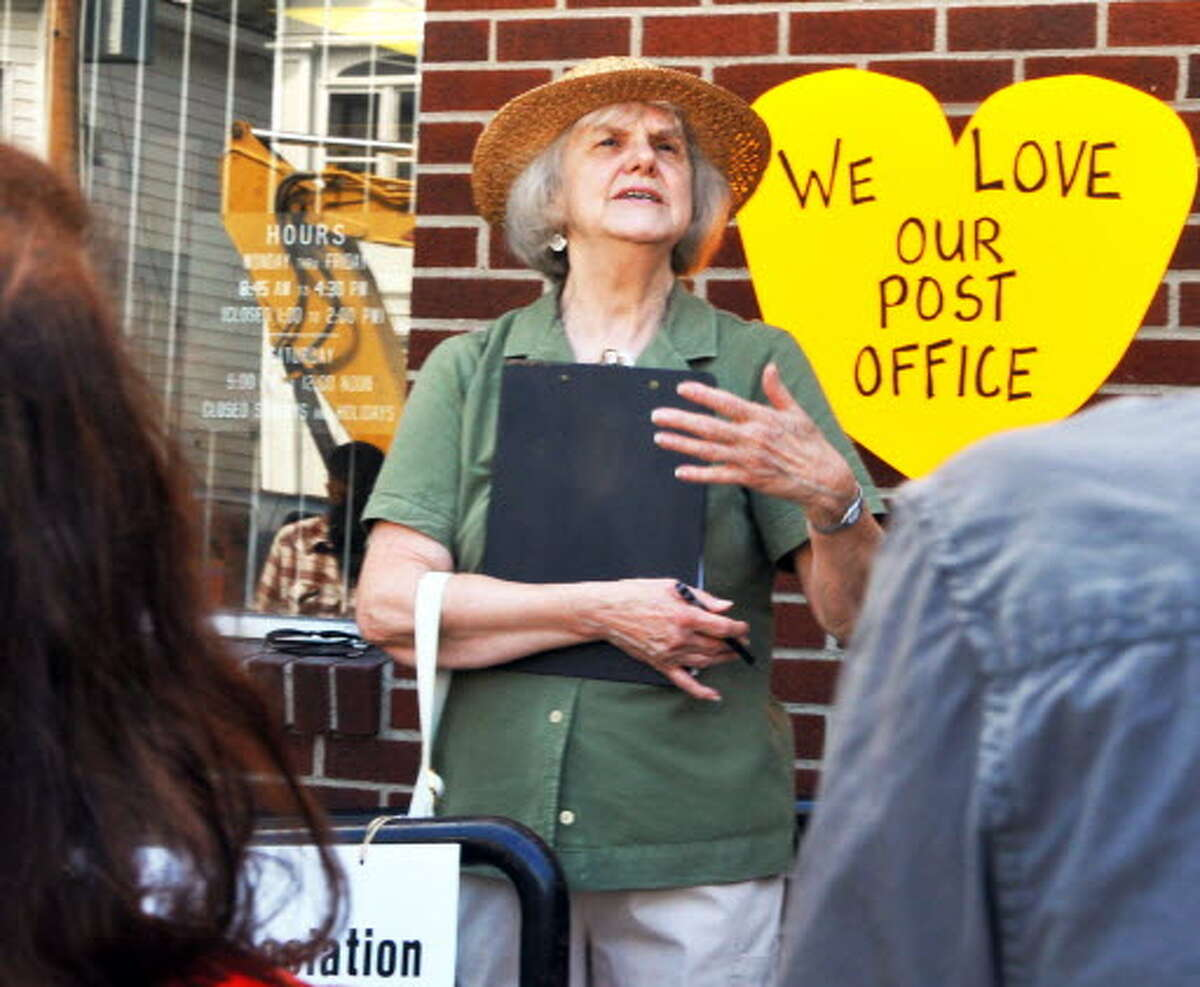 Eleanor Laing, a Delaware Avenue resident, speaks during a rally to save the Delaware Station Post Office on Tuesday August 11, 2009. (John Carl D'Annibale / Times Union archive)