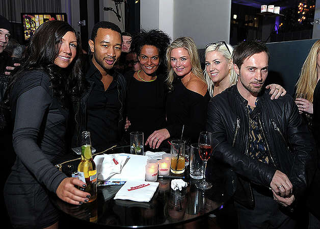 NEW YORK, NY - FEBRUARY 15:  Musician John Legend (2nd L) attends the SI Swimsuit Launch Party hosted By Pranna at Pranna Restaurant on February 15, 2011 in New York City.  (Photo by Michael Loccisano/Getty Images for Sports Illustrated) *** Local Caption *** John Legend Photo: Michael Loccisano, Getty Images For Sports Illustra / 2011 Getty Images