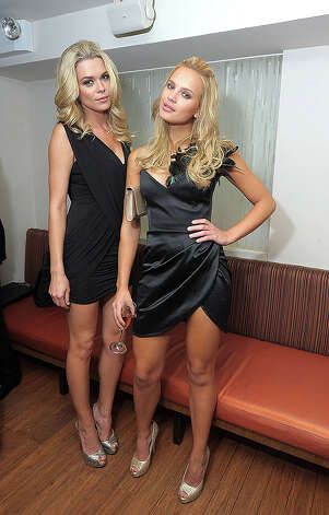 NEW YORK, NY - FEBRUARY 15:  Models Models Kasia Gogolkiewicz and Elisandra Tomacheski attend the SI Swimsuit Launch Party hosted By Pranna at Pranna Restaurant on February 15, 2011 in New York City.  (Photo by Michael Loccisano/Getty Images for Sports Illustrated) *** Local Caption *** Elisandra Tomacheski;Kasia Gogolkiewicz Photo: Michael Loccisano, Getty Images For Sports Illustra / 2011 Getty Images