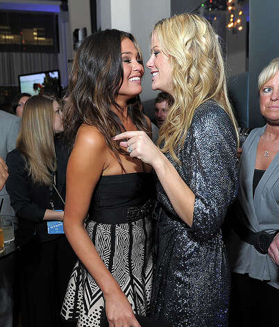 NEW YORK, NY - FEBRUARY 15:  Models Christine Teigen and Brooklyn Decker attend the SI Swimsuit Launch Party hosted By Pranna at Pranna Restaurant on February 15, 2011 in New York City.  (Photo by Michael Loccisano/Getty Images for Sports Illustrated) *** Local Caption *** Christine Teigen;Brooklyn Decker Photo: Michael Loccisano, Getty Images For Sports Illustra / 2011 Getty Images