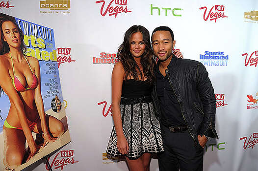 NEW YORK, NY - FEBRUARY 15:  Model Christine Teigen and musician John Legend attend the SI Swimsuit Launch Party hosted By Pranna at Pranna Restaurant on February 15, 2011 in New York City.  (Photo by Michael Loccisano/Getty Images for Sports Illustrated) *** Local Caption *** Christine Teigen;John Legend Photo: Michael Loccisano, Getty Images For Sports Illustra / 2011 Getty Images