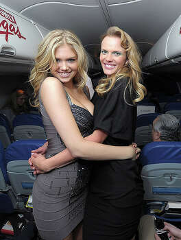 NEW YORK, NY - FEBRUARY 15:  Sports Illustrated swimsuit models Kate Upton and Anne V on board the Sports Illustrated Swimsuit 24/7: New York To Las Vegas Air Tran Flight on February 15, 2011 in New York City.  (Photo by Michael Loccisano/Getty Images for Sports Illustrated) *** Local Caption *** Kate Upton;Anne V Photo: Michael Loccisano, Getty Images For Sports Illustra / 2011 Getty Images