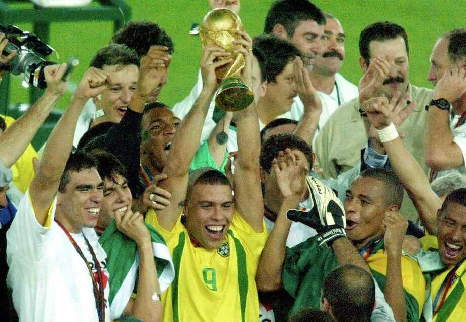Image result for brazil ronaldo world cup trophy