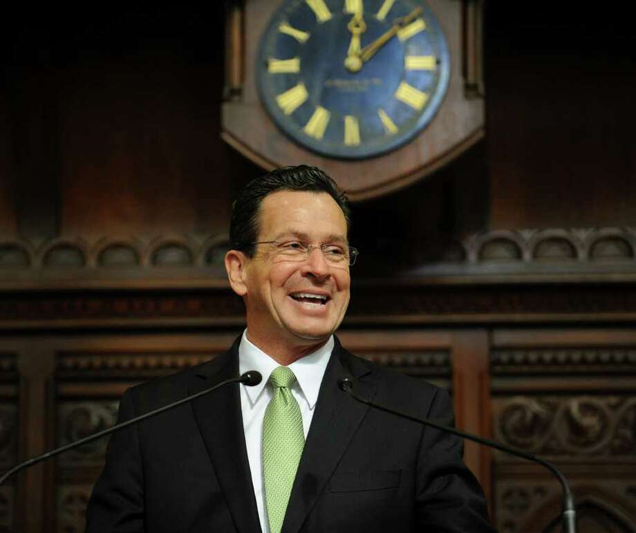 Governor Dannel P. Malloy smiles as he is applauded before presenting his budget address to a joint session of the General Assembly in Hartford on Wednesday, Feb. 16, 2011. Photo: Brian A. Pounds / Connecticut Post