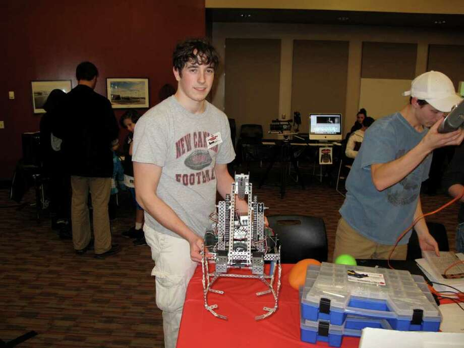 Will Nemiroff shows off New Canaan's robot for the Vex Robotics Competition. Photo: Contributed Photo;Paresh Jha Staff Photo, Contributed Photo / New Canaan News