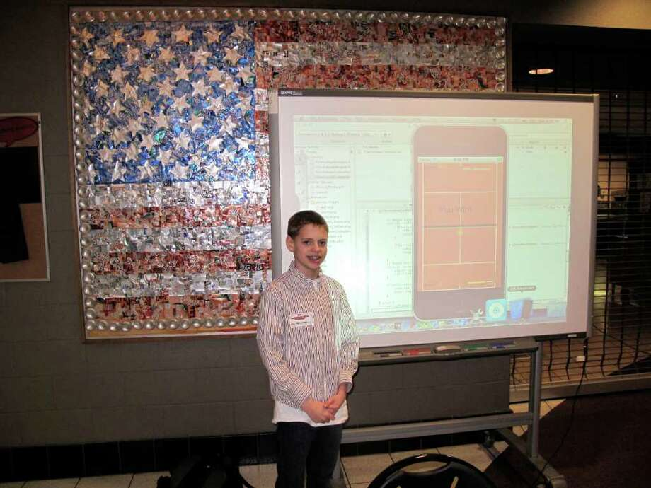 12-year-old child prodigy, Trey Oehmler, stands beside a display of his new video game/iPhone app iTennis. Photo: Contributed Photo;Paresh Jha Staff Photo, Contributed Photo / New Canaan News
