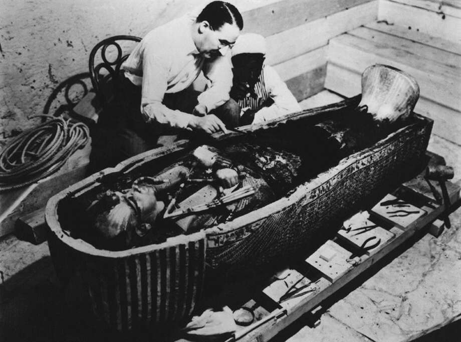 Howard Carter, the archaeologist who discovered Tutankhamun's tomb, is shown examining King Tut's sarcophagus, date unknown. (AP Photo)