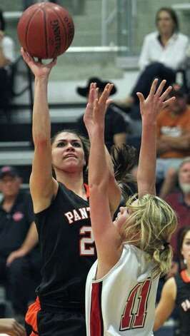 Lady Panther Carmen Maciel puts up a shot against Kelsey Flanagan as the Medina Valley girls beat Canyon in 4A high school basketball playoff action at South San gym on February 15, 2011.  Tom Reel/treel@express-news.net Photo: Tom Reel/treel@express-news.net