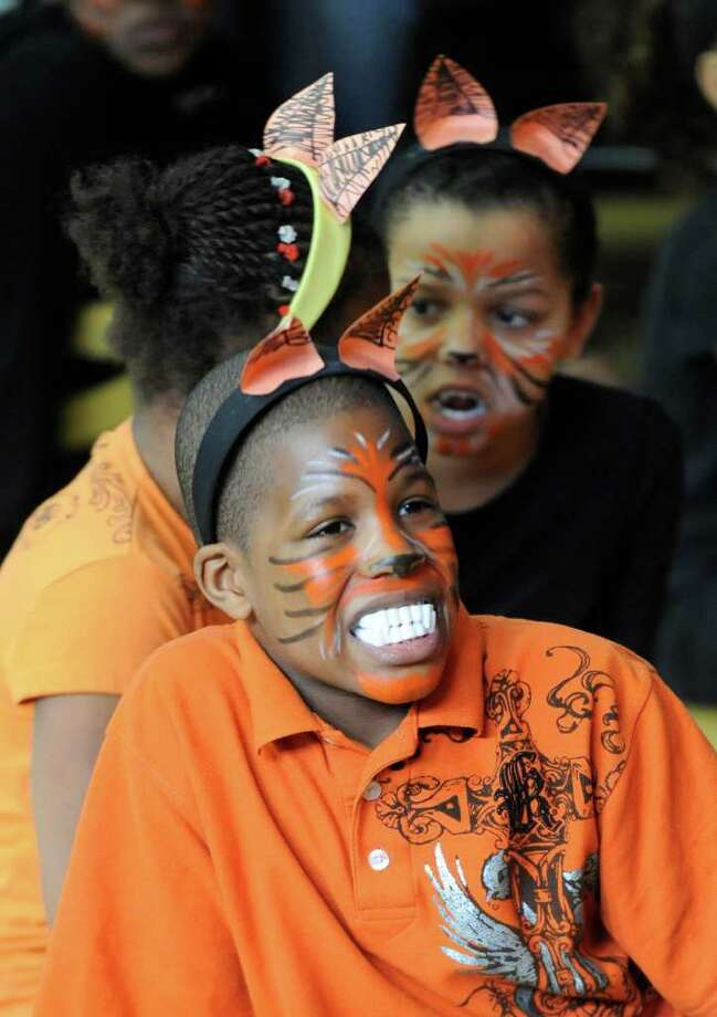 "Tyler Caldwell shows off his ""tiger"" teeth as he joined other third graders from Troy School 2 during a performance of native dance of Nigeria February 16, 2011, as part of a program that studied the customs of the country in dance, storytelling and art under the supervision of The Arts Center of the Capital Region with a grant from First Niagara Bank.  (Skip Dickstein / Times Union) Photo: Skip Dickstein"