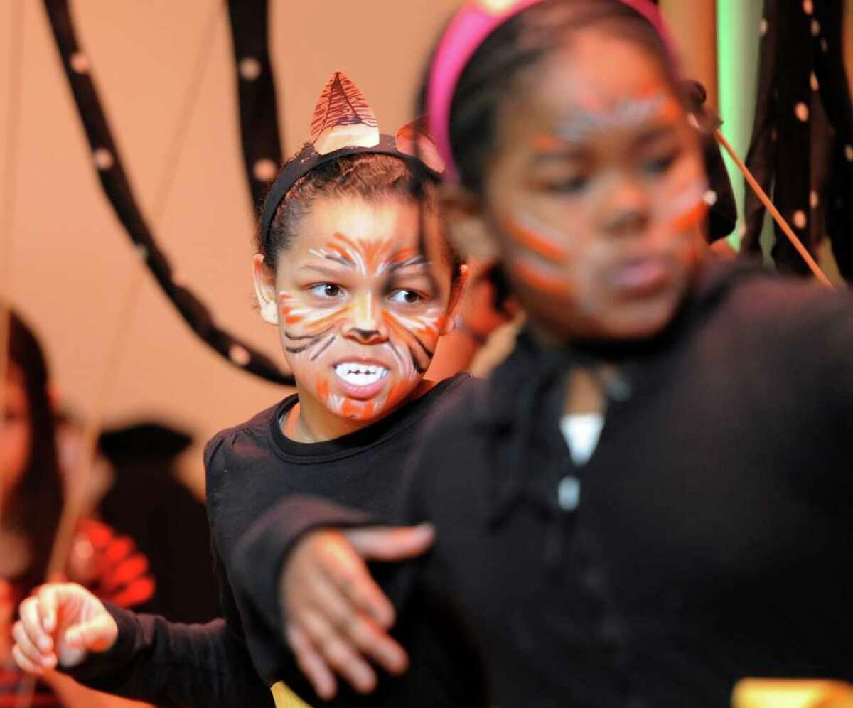 Troy School 2 student Salyssa Wagar shows her fangs as she performs a native dance of Nigeria on February 16, 2011, as part of a program that studied the customs of the country in dance, storytelling and art under the supervision of The Arts Center of the Capital Region with a grant from First Niagara Bank. (Skip Dickstein / Times Union)
