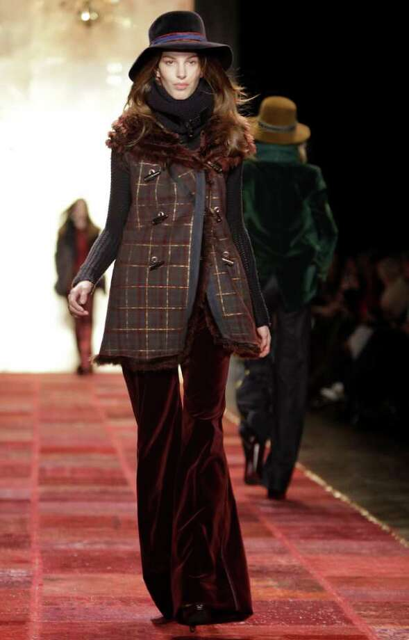 A model walks the runway at the Tommy Hilfiger Fall 2011 show during Fashion Week at Lincoln Center in New York, Sunday, Feb. 13, 2011.  (AP Photo/Kathy Willens) Photo: Kathy Willens, STF / AP