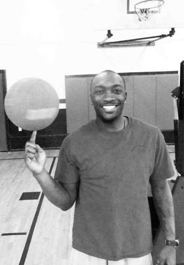 "Pictured is Ron Christy, a former member of the Harlem Globetrotters who is currently the basketball coordinator for the Westport Weston Family Y. Christy juggles his YMCA work with his role as a ""dunker"" for the Harlem Wizards. Photo: Kirk Lang / Westport News"