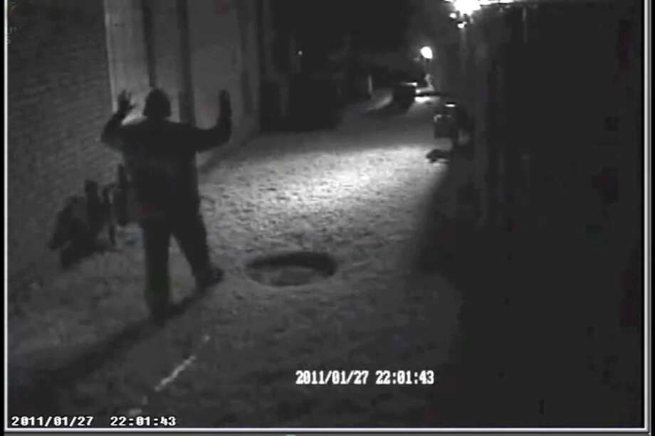 An unidentified man is held at gunpoiint by a homeowner who caught him peeping into a neighbor's window on Januray 27, 2011, in the Beaumont's West End in this image taken from a security video. Photo/Beaumont Police Dept.