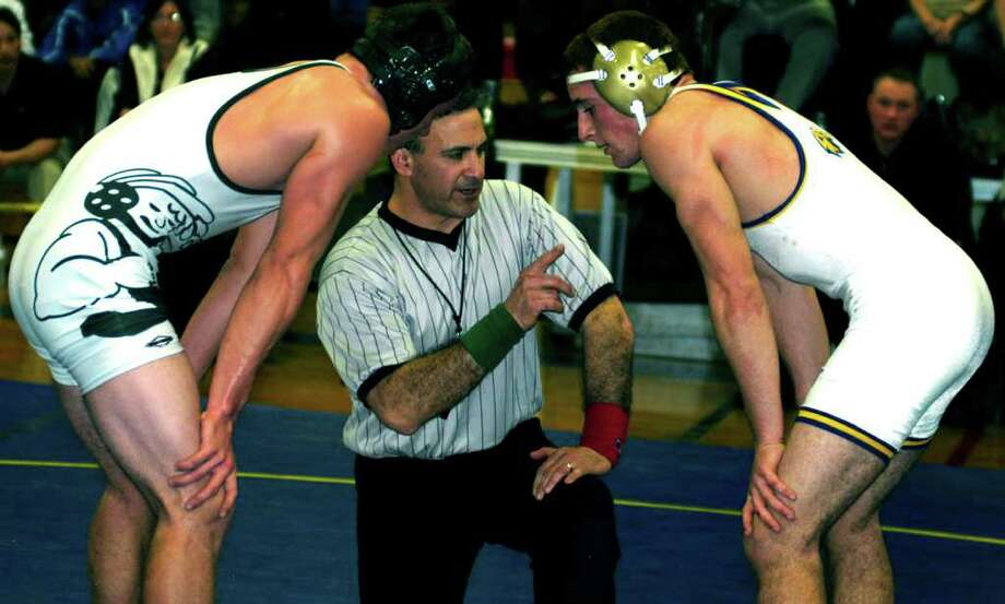 SPECTRUM/Karl Bradshaw, left, is the champion at 171 pounds for New Milford High School wrestling at South-West Conference tournament, Feb. 12, 2011 at Brookfield High School. Photo: Norm Cummings / The News-Times